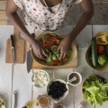 Young African Woman Cooking Salad